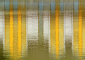 Yellow mirroring on the water — Stock Photo