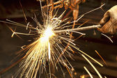 Metal fabricator utilizing a torch — Stock Photo