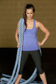 Woman posing with atheltic training ropes — Stock Photo