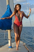 Hispanic female model posing on a sailboat — Stock Photo