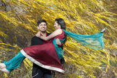 Young Indian Man Carrying His Bride — Stock Photo