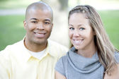 Young couple posing on a sunny day — Stock Photo