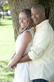 Young interracial couple in the park — Stock Photo