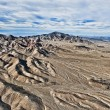 Dry desert  from a helicopter. — Stock Photo #50562931