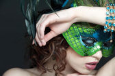 Attractive woman holding the mask — Stock Photo