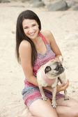 Female model posing at the beach — Stock Photo