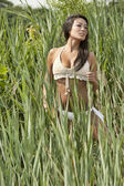 Model standing in a grassy field — Stock Photo
