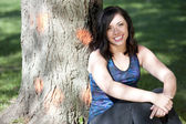 Young attractive girl posing near a tree — Stock Photo