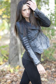 Young girl posing in a leather jacket — Stock Photo