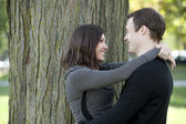 Attractive couple at a park — Stock Photo