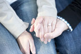 Hands holding with an engagement ring — Stock Photo