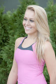 Blond young girl wearing athletic top — Stock Photo