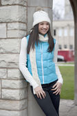 Brunette girl wearing a white hand and a blue jacket — ストック写真