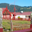Maori marae (meeting house and meeting ground) - Stock Photo