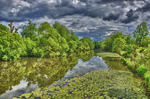 Fulda river in HDR Aueweiher Park in Fulda, Hessen, Germany — Stock Photo