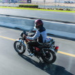 Stock Photo: DUBAI, UAE - DECEMBER 23: Biker with a motorcycle Yamaha in motion blur on Sheikh Zayed Road on December 23, 2013 in Dubai, UAE.