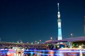 Tokyo skytree blue illumination beside sumida river, Tokyo, Japan — Stock Photo