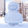 Little girl wearing down with hat, Sapporo Snow Festival 2013 — Stock Photo #21863225