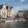 Gent - Typical old houses in morning light from Korenlei street on June 24, 2012 in Gent, Belgium. -  