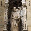 Florence - st. Mark the Evangelist by Donatello on the facade of Orsanmichele - Stock Photo
