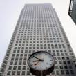 London - clock and facade of Canary Wharf Tower - Stock Photo
