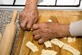 Hands of grandmother at cooking — Stock Photo