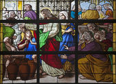 BRUSSELS - JUNE 21: Jesus by miracle in Cana. Detail from windowpane of st. Nicholas church on June 21, in Brussels. — Stock Photo
