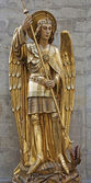 BRUSSELS - JUNE 22: Saitn Michael the archangel statue in st. Michael s gothic cathedral on June 22, 2012 in Brussels. — Stock Photo