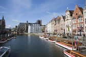Typical palaces from Korenlei street with the canal and Saint Michael church in morning light in Gent, Belgium. — Stock Photo