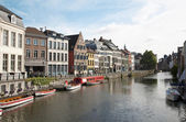 GENT - JUNE: Typicali street vitht the canal on June 24, 2012 in Gent, Belgium. — Stock Photo