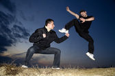 Karate training in evening — Stock Photo