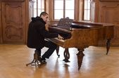 Piano player in old castle — Stock Photo