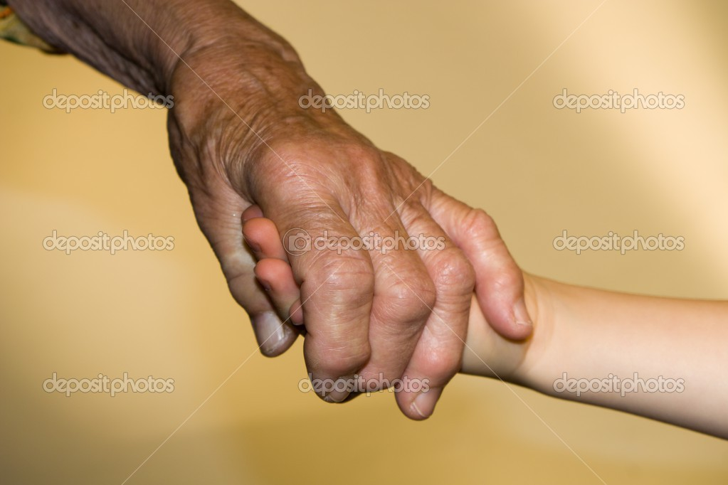 Hands of senior and child  Foto Stock #13140621
