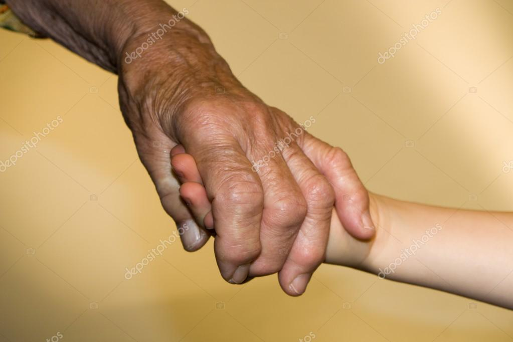 Hands of senior and child  Stockfoto #13140621