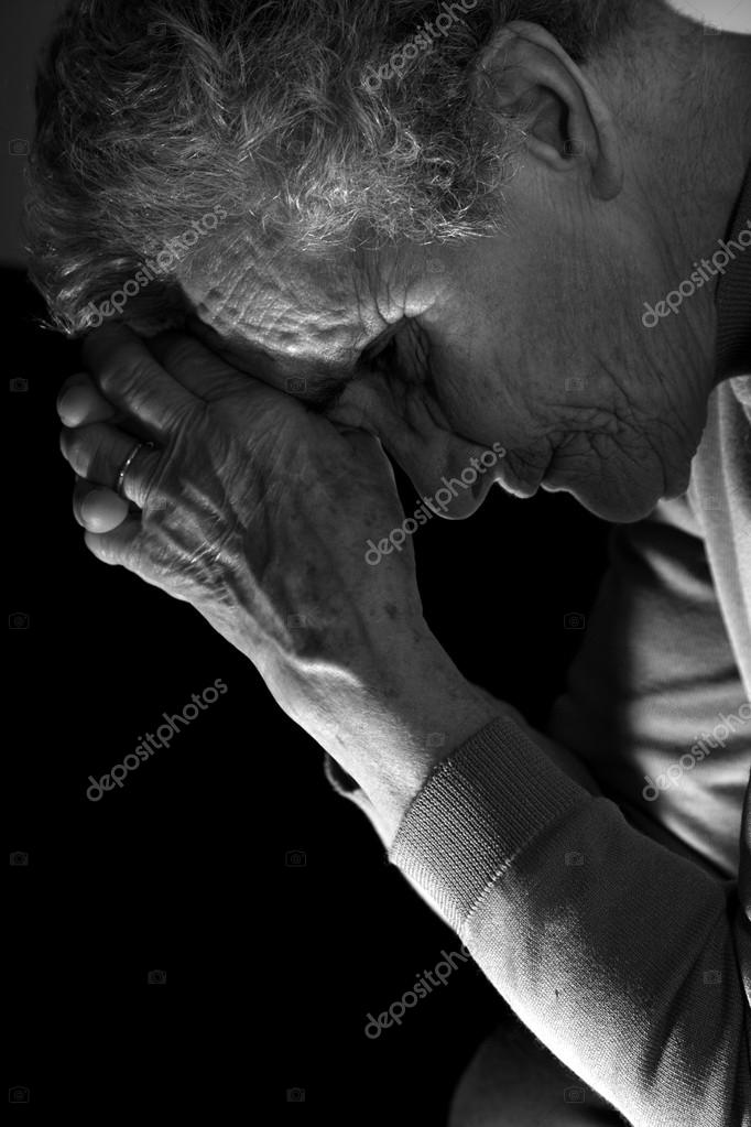 meditation of old woman by the candle — Stock Photo #13141360