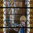 LEVOCA - AUGUST 1: Annunciation from windowpane in Basilica of Visitation of Virgin Mary on August 1, 2012 in Levoca, Slovakia. - Stockfoto