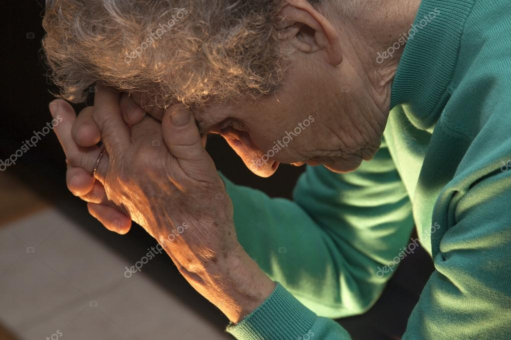 Meditation of old woman at candle light — Stockfoto #14352297