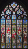 BRUSSELS - JUNE 22: Saints from windowpane in gothic church Notre Dame du Sablon on June 22, 2012 in Brussels. — Stock Photo