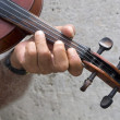 Stock Photo: Hand der old violin player