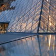 Paris - pyramid in Louvre in evening - Stock Photo