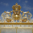 Paris - gold gate of Versailles palace - Stock Photo