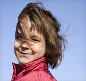 Portrait of little girl in the wind — Stock Photo