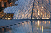 Paris - pyramid in Louvre in evening — Stock Photo