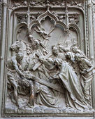 Milan - detail from main bronze gate - Jesus under cross — Stock Photo