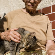 Grandmother with the cat — Stock Photo