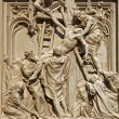 Stock Photo: Mil- detail from main bronze gate - deposition from cross
