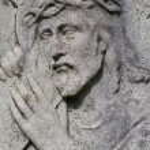 Jesus with the cross - stone relief — Stock Photo #14891953
