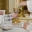 Hands of priest by the mass — Stock Photo