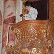 Stock Photo: Priest by homily on pulpit at tridentine mass