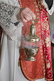 Hand of catholic priest at incense — Stock Photo